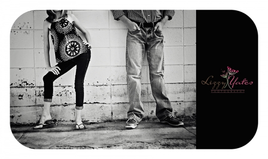 Brother and sister pair strike a pose in a grungy parking lot for this urban shot in West Little Rock