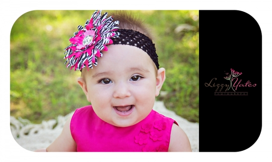 Sweet Baby Girl with a pink flower headband Smiles in a Little Rock Park