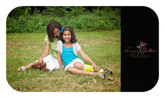 A mother looks lovingly at her daughter for a family photograph near downtown Little Rock