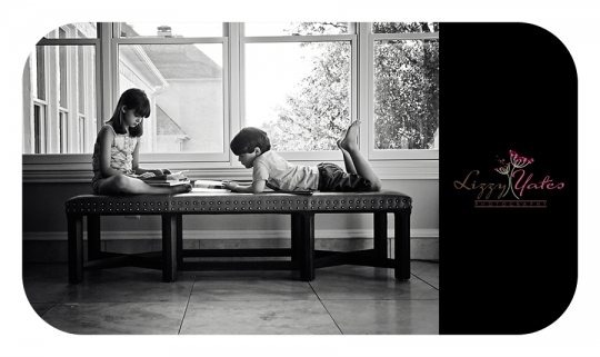 A brother and sister read together at home during a little rock photography session