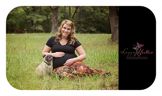 She smiles and hugs her pregnant belly as her best furry friend sits next to her near Little Rock Arkansas