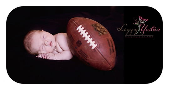 A baby boy and his football during a photo session in West Little Rock Arkansas