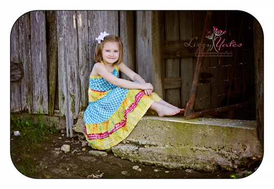 6 year old girl in a barn door during little rock family photography session
