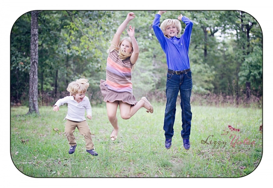 Three little rock kids jump for joy during their pictures