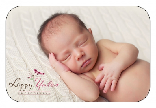 Sweet Newborn Baby Girl during her little rock custom photography session