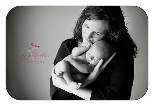 A newborn baby boy and his mom during pictures in little rock