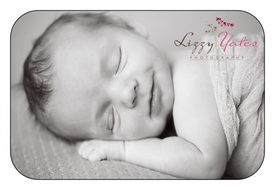 baby smiles during little rock newborn pictures