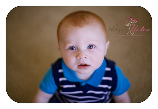handsome 6 month old boy during photo session in little rock arkansas