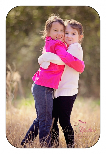 sisterly love during family picturs in little rock arkansas
